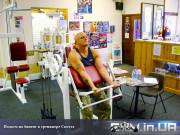 Упражнение: Подъем на бицепс в тренажере Скотта