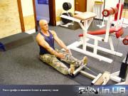 Упражнение: Тяга грифа к животу в нижнем блоке сидя