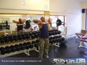 Упражнение для трапеции: Вертикальная тяга грифа к подбородкустоя
